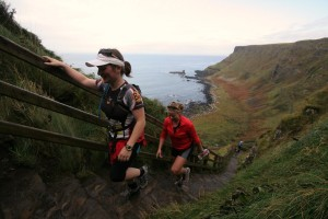 Di Di and Reilly running up the step at the Giant's Causeway